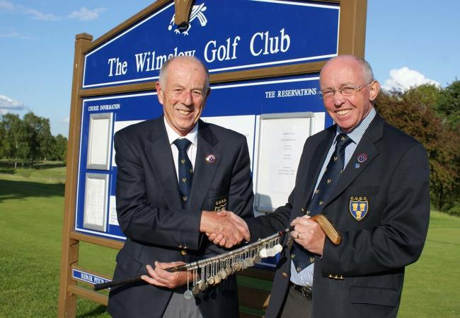 Roy Smethurst presented with the president's putter by Andrew Henshall
