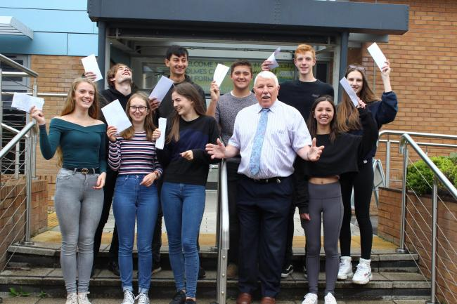 Students celebrate their exam successes with head teacher Denis Oliver
