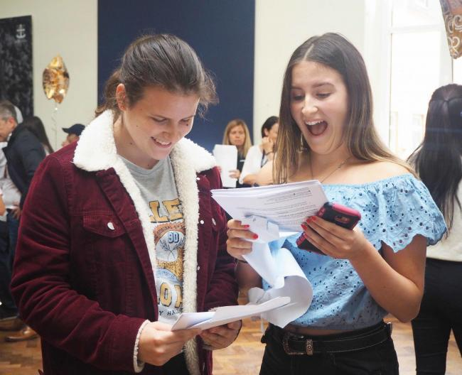 Twin sisters Lara and Ella Coulter celebrate their outstanding results