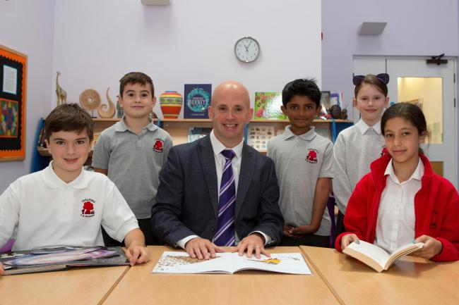 New headteacher Andy Brady with new pupils at Chelford PrimarySchool