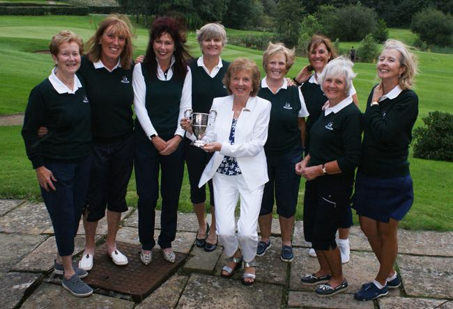 The Delamere team presented with the Bell Cup by Linda England