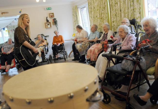 Residents take part in the music therapy session