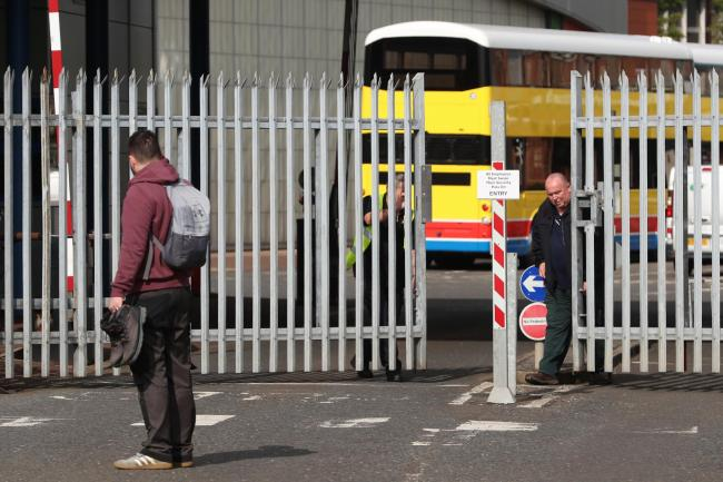 Security workers close the gates at the Wrightbus plant in Ballymena