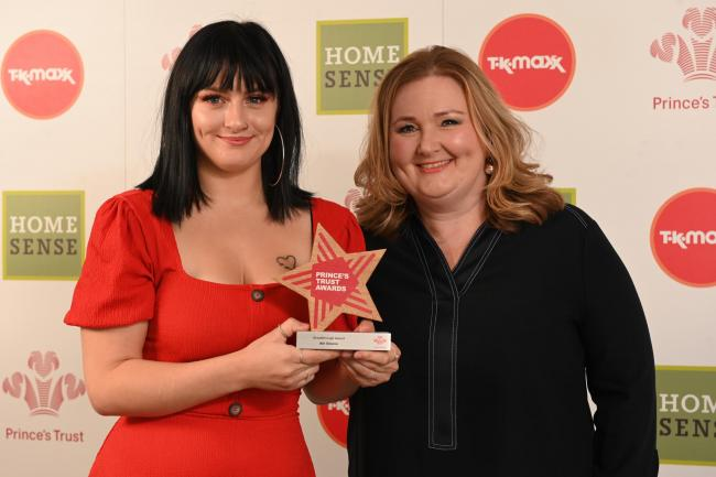 Abi Gleave receives the award from Ashley Nelson from M and S Bank