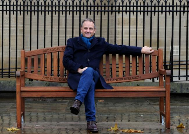 Mark Radcliffe relaxes on the engraved bench