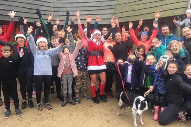 Bootcamp supporters, with Sam Ban Murray in the centre dressed as Mrs Claus