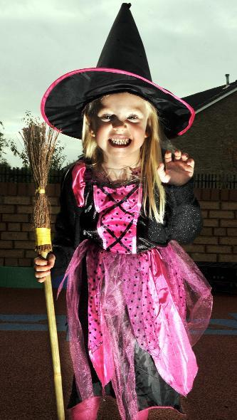 Knutsford Guardian: Pictured in her witch outfit is Amy Powley, aged five.