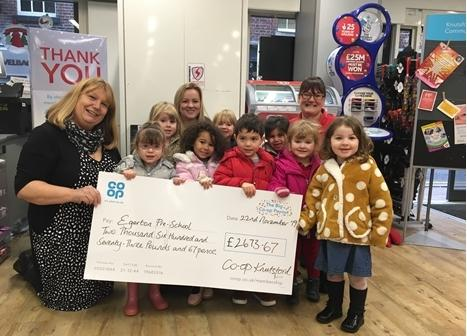 Staff and children with the Co-op cheque