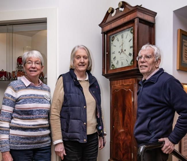 Mary Gracie, Val and David Bryant admire the clock. Pictures by Peter Spooner