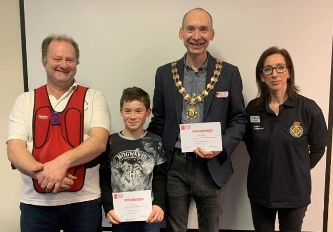 Cllr Malloy and his son show their Heartstart certificates, with Steve Nixon, who was course instructor, and Toni Frisciola, First Responders and Heartstart Facilitator