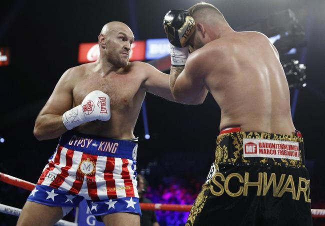 Flashback to Tyson Fury's clash with Germany's Tom Schwarz in Las Vegas 12 months ago. Picture: PA Wire/AP Photo/John Locher