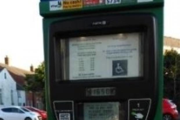 LETTER:  It is ludicrous you can't use money in the parking machines