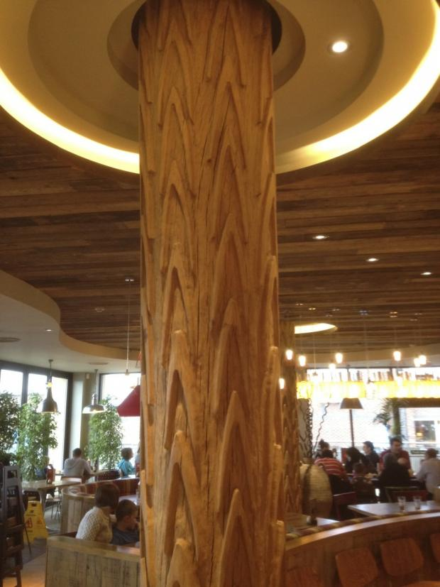 Knutsford Guardian: A Nando's column in a restaurant in Oldham. Made of solid oak, it stands at four metres high, with a design based on African mud huts.