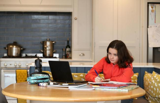 Knutsford Academy student Sophie Symes learning in her kitchen. Image: PA/Martin Rickett