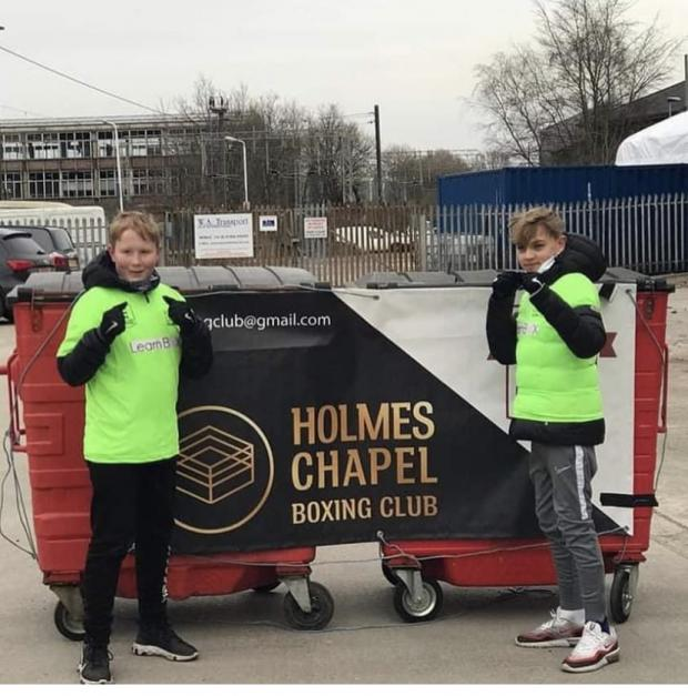 Knutsford Guardian: Ollie and Alfie walked a marathon in a day to raise funds for Holmes Chapel Boxing Club.