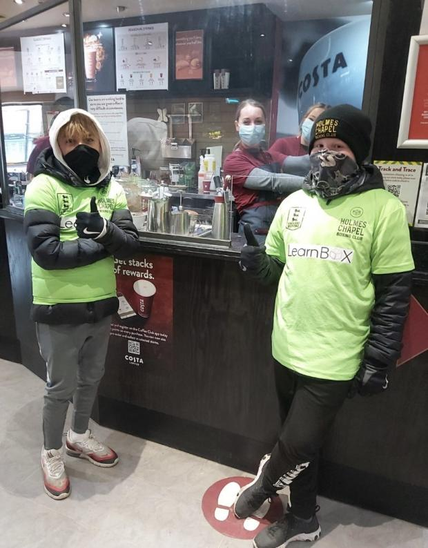 Knutsford Guardian: Ollie and Alfie took a pit stop and a moment to get warm at Costa Coffee