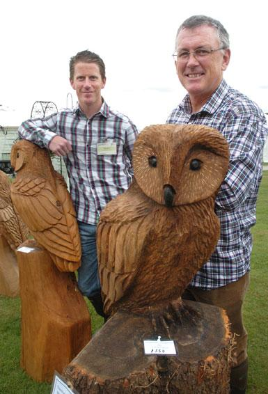 Andy and Tim Burgess, of Rostherne, with their chainsaw carvings.