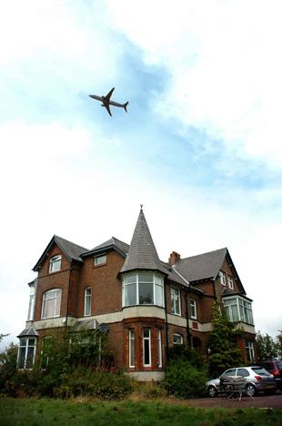 An aircraft flies over Hobcroft House 	Pictures: Nick Jones