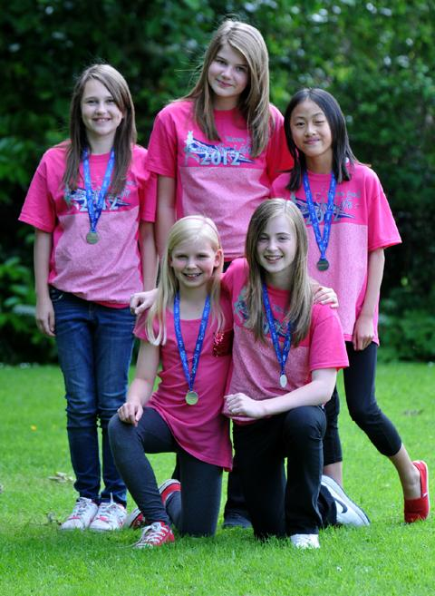 Race for Life girls, front, Jessie, nine and Alice Page, 12, and friends Lilymay Hassall, Emily Boom and Melissa Goodchild, all aged 12                                          r1227215