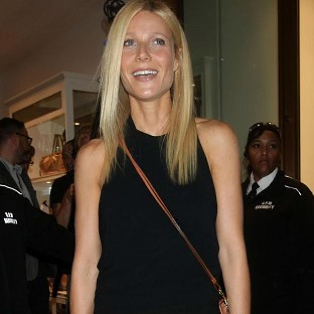 Gwyneth Paltrow was left blushing after hubby Chris Martin gave her a surprise public kiss