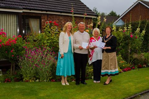 Lorraine and Ted Dorsett of Woodside picked up first prize in the front garden competition for their colourful display Clr Vivien Davies and Yvonne Bancroft presented the award to the couple in 2012