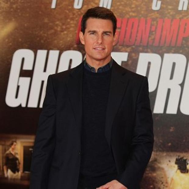 Tom Cruise has paid tribute to Top Gun director Tony Scott