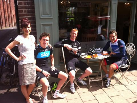 The cyclists take a break with coffee shop owner  Mercedes Grayson         Picture: Joe Walker