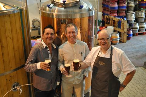 Left, Paul Newman and David Mooney, far right, toast the new ale with Tatton Brewery's Gregg Sawyer
