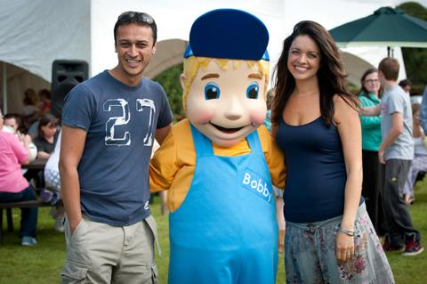 Actor Chris Bisson, with CAFT patron Jennifer James and farm mascot Bobby