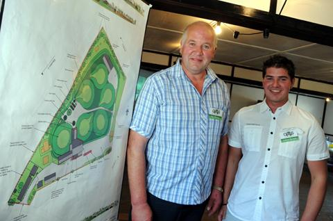 Ray Brown with his son Adam next to plans for the green energy plant