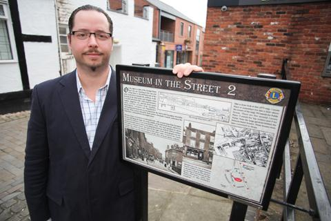 Jonathan Farber with the new 'Museum in the Street' sign