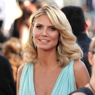 Model and presenter Heidi Klum arrives at the Nokia Theatre in Los Angeles for the Emmy Awards (AP)