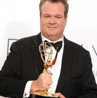 Eric Stonestreet poses with his Emmy award, won for his role in Modern Family (AP)
