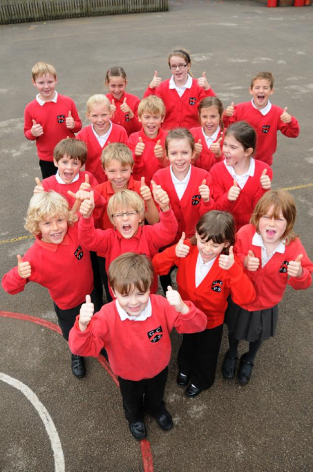 Pupils at Goostrey School celebrate their glowing assessment          n124156