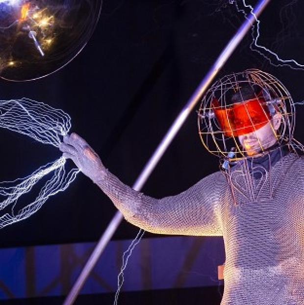 David Blaine stands inside an apparatus surrounded by a million volts of electric currents (AP/John Minchillo)