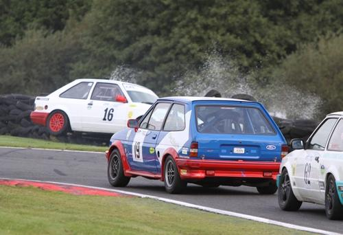 John Biddulph approaches the incident in car number 19. Picture by Eddie Whitham