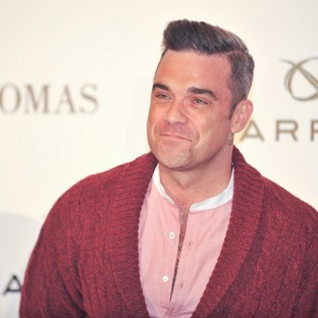 Robbie Williams has pledged his X Factor support to Rylan Clark