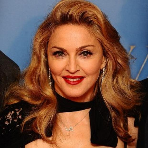 Madonna urged fans at her concert to vote for Obama