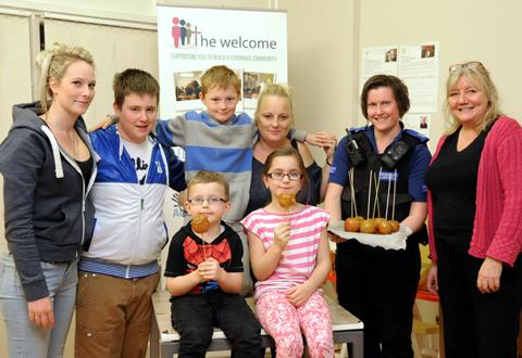 Parents and children with PCSO Jenny Regan, second from right, and Welcome operations manager Marie Fox, right                          n124570