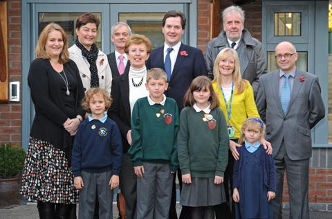 George Osborne MP and Jeff Gazzard with pupils and staff at Mobberley Primary School