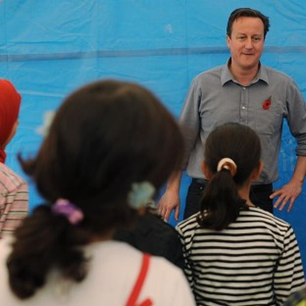 Knutsford Guardian: Prime Minister David Cameron meets children and teachers in a classroom at the Za'atri refugee camp near the Syrian - Jordanian border