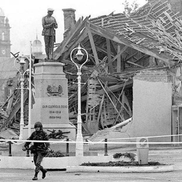 Knutsford Guardian: A community centre lies in ruins the morning after the IRA bombing of a Remembrance Day ceremony in the town of Enniskillen 25 years ago