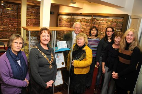 Knutsford in Bloom chairman Yvonne Bancroft, right, with volunteers, town councillors and town mayor Vivienne Davies, at Knutsford Heritage Centre                                                   n1247148