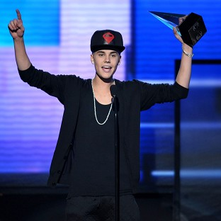 Justin Bieber accepts the award for favourite pop/rock album at the American Music Awards (AP)