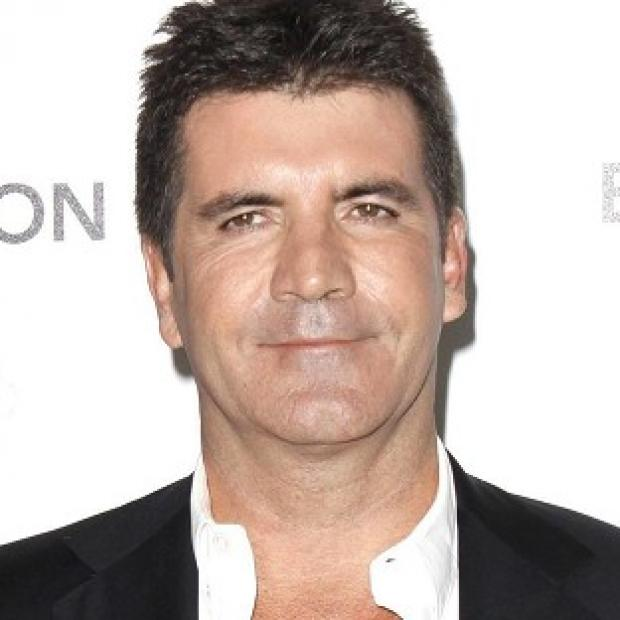 Simon Cowell has criticised Martin Gore for saying he should be shot