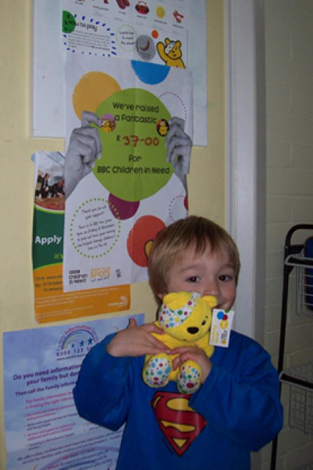 Drew Comline with his winning Pudsey bear