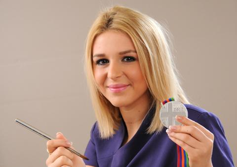 Nail technician Eve Booth with her silver medal 	N124990