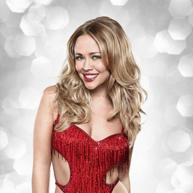 Kimberley Walsh and Pasha Kovalev dazzled the Strictly judges with a tango crossed with cha cha to The Weather Girls hit It's Raining Men