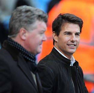 Tom Cruise pitchside before kick-off in the Barclays Premier League match at the Etihad Stadium, Manchester