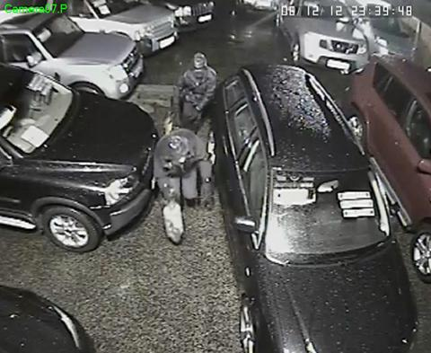 Knutsford Guardian: A CCTV image of the thieves examining a car